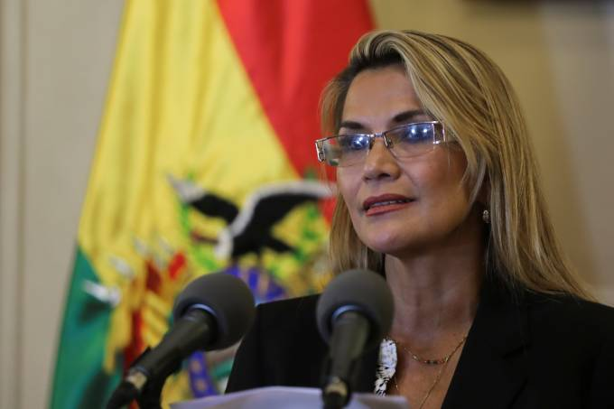 Bolivian Interim President Jeanine Anez talks to the media during a news conference at the Presidential Palace, in La Paz