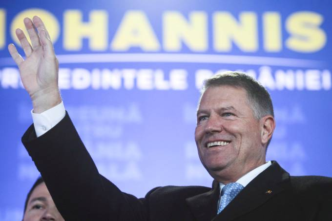 Incumbent candidate Klaus Iohannis reacts after receiving the first exit poll results following the second round of a presidential election
