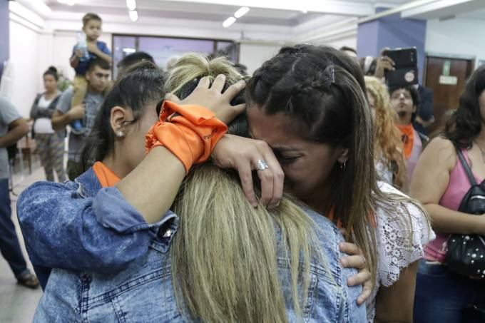 Activists celebrate at a courthouse after the hearing of the sentence on a trial in which Italian and Argentine catholic priests Nicola Corradi, Horacio Corbacho and former gardener Armando Gomez were accused of sexual abuse, in Mendoza