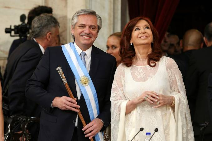 Argentina's President Alberto Fernandez holds the symbolic leader's staff after he was sworn in as Argentina's next president, in Buenos Aires