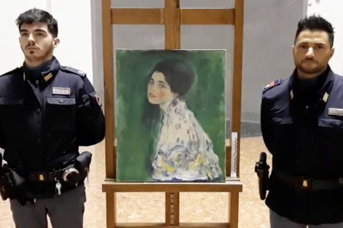 Italian police stand next to what they say is a masterpiece by Austrian artist Gustav Klimt that was stolen in 1997 and was found hidden in an outside wall of an Italian gallery, in Piazcenza