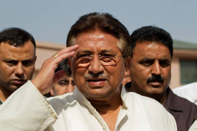 FILE PHOTO: Pakistan's former President Musharraf salutes as he arrives to unveil his party manifesto for the forthcoming general election at his residence in Islamabad