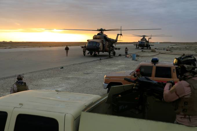 Iraqi Air Force helicopters land at Ain al-Asad airbase in the Anbar