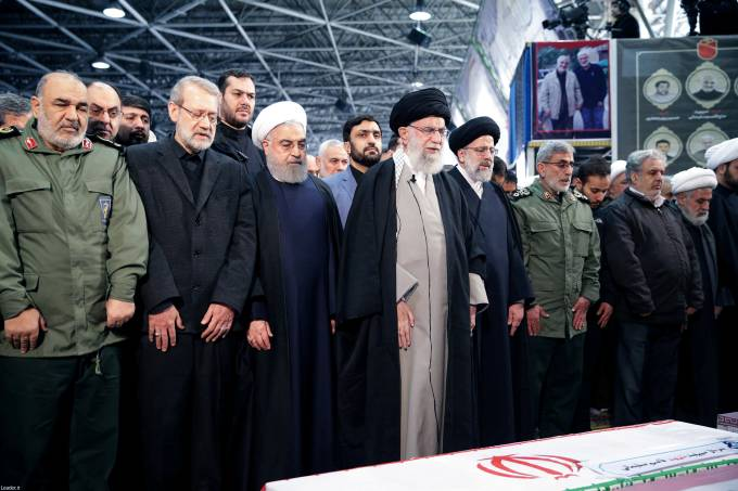 Iran's Supreme Leader Khamenei and President Rouhani pray near the coffin of Iranian Major-General Qassem Soleimani in Tehran