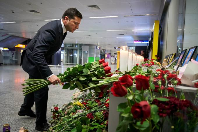 Ukrainian President Volodymyr Zelenskiy lays flowers to commemorate victims of the Ukraine International Airlines Boeing 737-800 plane crash, at a memorial in Boryspil International airport