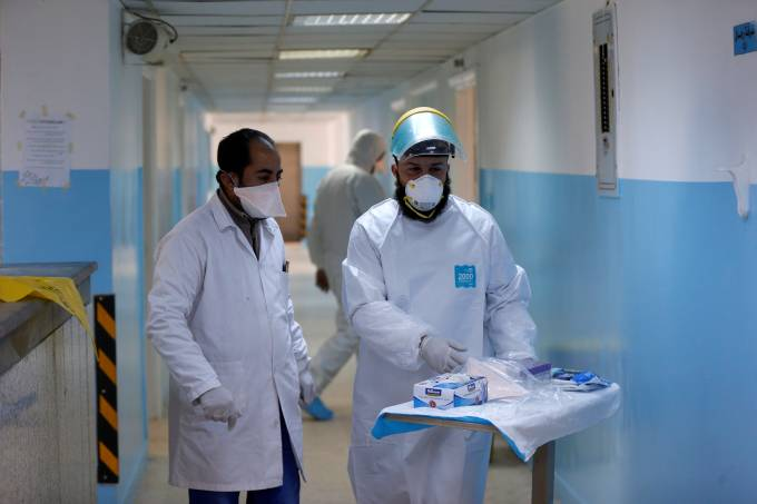 Members of the medical staff work at a new section specialised in receiving any person who may have been infected with coronavirus, at the Al-Bashir Governmental Hospital in Amman
