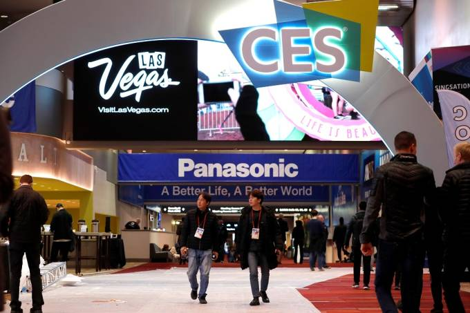 Workers and exhibitors walk through the lobby of the Las Vegas Convention Center as they prepare for the 2020 CES in Las Vegas