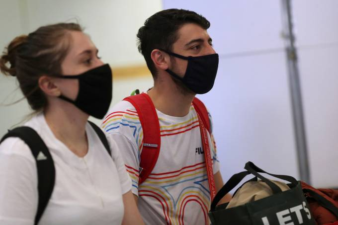 Travellers arrive on a flight from China at Guarulhos International Airport, in Guarulhos