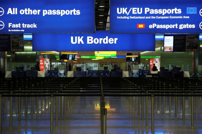 FILE PHOTO: UK Border control is seen in Terminal 2 at Heathrow Airport in London