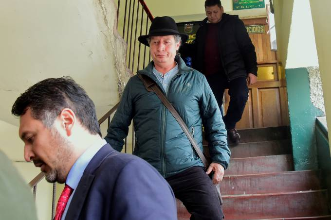 Bolivia's former Mining Minister Cesar Navarro leaves the office of FELCC after he was detained at the airport trying to board a flight to Mexico, in La Paz
