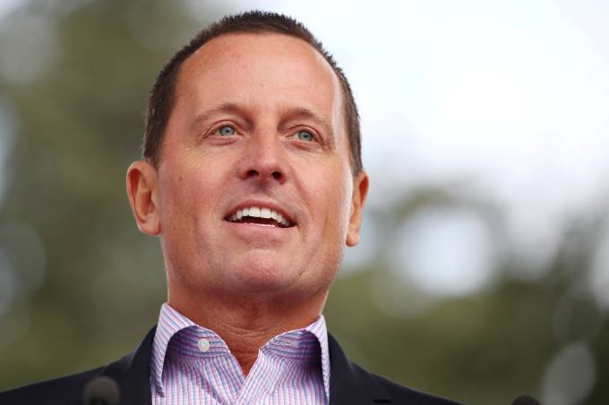 """FILE PHOTO: Grenell, U.S. ambassador to Germany, attends the """"Rally for Equal Rights at the United Nations (Protesting Anti-Israeli Bias)"""" in Geneva"""