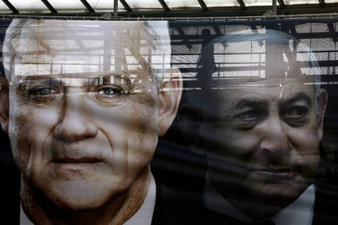 FILE PHOTO: A banner depicts Benny Gantz, leader of Blue and White party, and Israel Prime minister Benjamin Netanyahu, as part of Blue and White party's campaign ahead of the upcoming election, in Tel Aviv