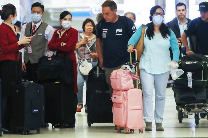 Flight Crews Wear Protective Gear For International Flights