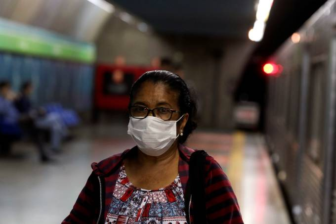 A passenger wears a protective facemask at a subway station after the first case of coronavirus was confirmed in Sao Paulo