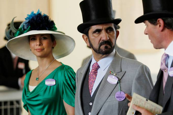FILE PHOTO: Jordanian Princess Haya bint Al-Hussein and husband Dubai ruler Sheikh Mohammed bin Rashid al-Maktoum walk to the parade ring on Ladies Day the third day of racing at Royal Ascot in southern England