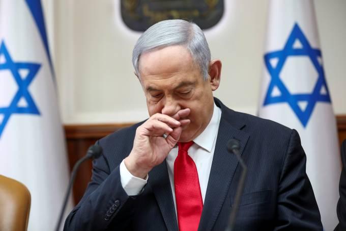 Israeli Prime Minister Benjamin Netanyahu gestures as he chairs the weekly cabinet meeting in Jerusalem