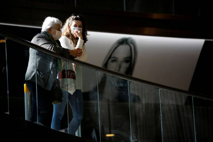 FILE PHOTO: Women wear masks inside a terminal at Ben Gurion International airport in Lod, near Tel Aviv, Israel