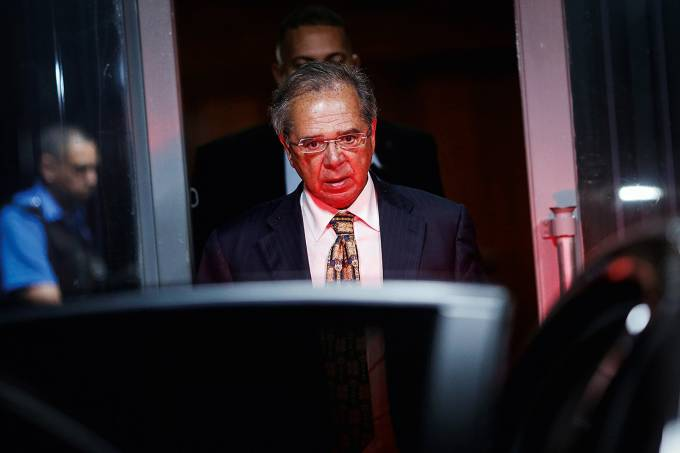 Brazil's Economy Minister Paulo Guedes leaves the Ministry of Economy building in Brasilia