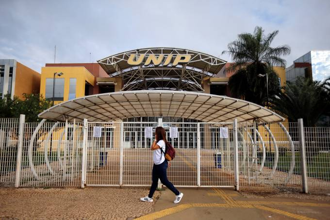 Student arrives at a university that is closed for five days after reports of the coronavirus in Brasilia
