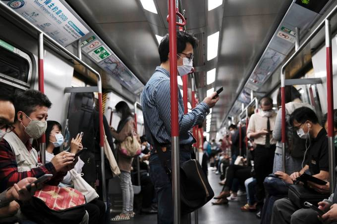 People wear protective masks in an MTR train, following the outbreak of the new coronavirus in Hong Kong