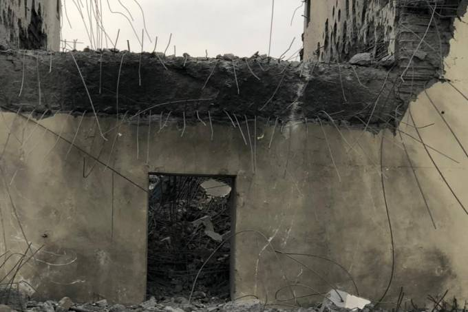 A damaged building, which according to the Iraqi religious authorities was hit by an U.S. airstrike, is seen in an undisclosed location in this picture provided by Iraqi Media Security Cell