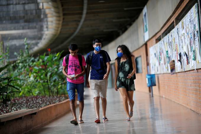 Students wear protective face masks at the University of Brasilia (UNB), as it is closed for five days after reports of the coronavirus in Brasilia