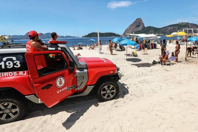 Lifeguards alert people about the coronavirus disease (COVID-19) outbreak at Flamengo beach in Rio de Janeiro
