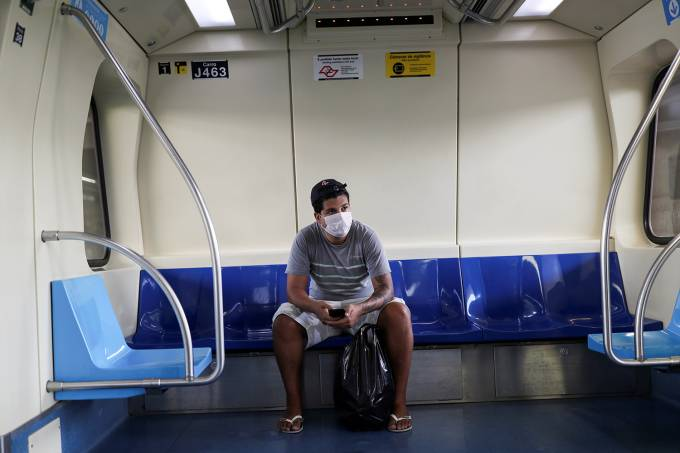 A passenger wears a protective face mask as a precautionary measure against coronavirus disease (COVID-19) on a subway train in Sao Paulo