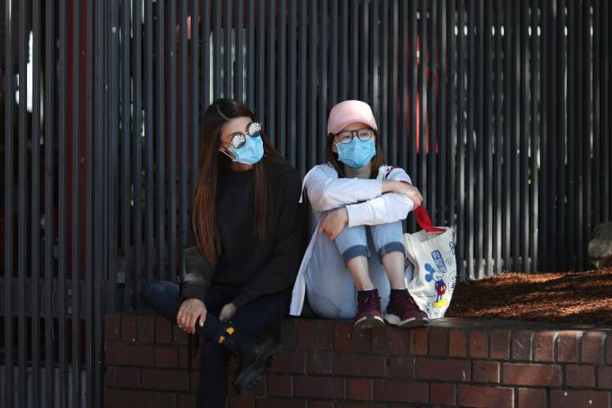 Women wear protective face masks amidst fears of the coronavirus disease (COVID-19) in Sydney