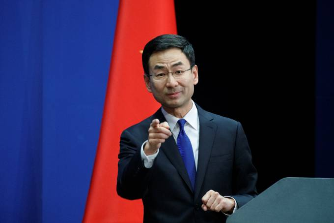 Chinese Foreign Ministry spokesman Geng Shuang takes a question from a journalist during the daily press briefing of the Foreign Ministry in Beijing