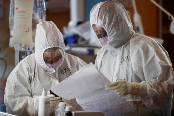 Medical workers in protective suits treat patients suffering with coronavirus disease (COVID-19) in Rome