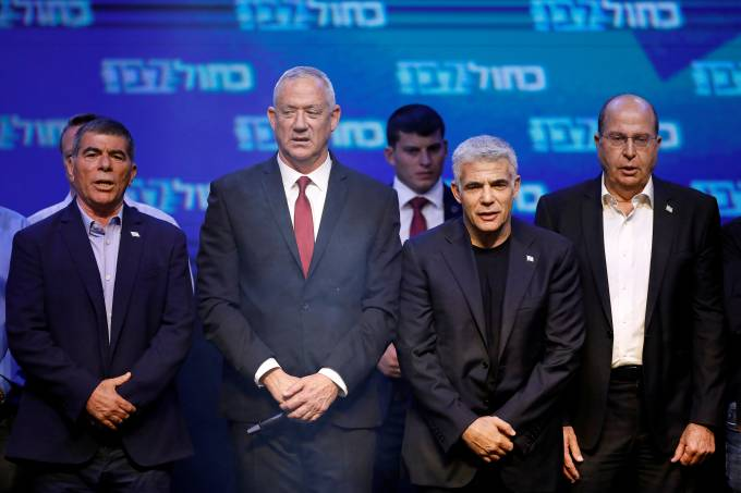 FILE PHOTO: Blue and White party leader Benny Gantz and party co-leaders Yair Lapid, Moshe Yaalon and Gaby Ashkenazi react at the party's headquarters following the announcement of exit polls during Israel's parliamentary election in Tel Aviv