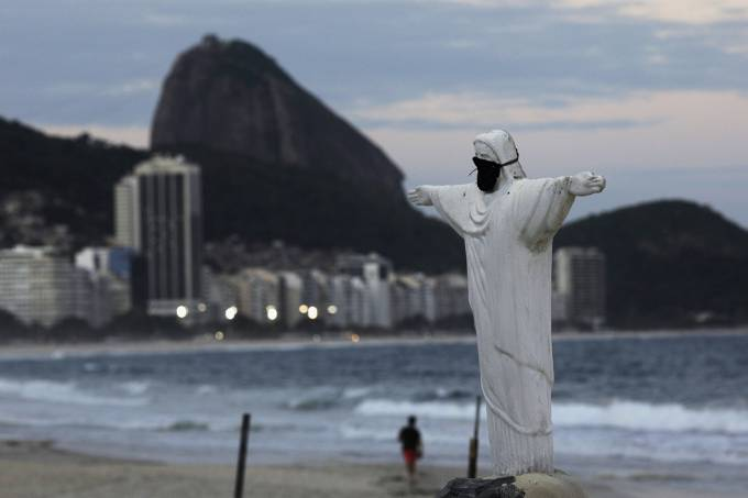 A Christ the Redeemer statue made from sand is pictured with protective mask in Copacabana beach during the coronavirus disease (COVID-19) outbreak, in Rio de Janeiro