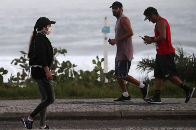 People walk at Recreio dos Bandeirantes beach, amid the coronavirus disease (COVID-19) outbreak, in Rio de Janeiro