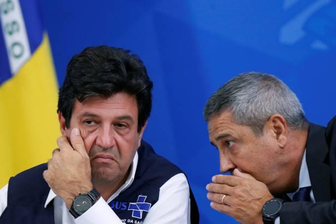 Brazil's Chief of Staff Minister Walter Souza Braga Netto talks with Brazil's Minister of Health Luiz Henrique Mandetta during a news conference, amid the coronavirus disease (COVID-19) outbreak in Brasilia