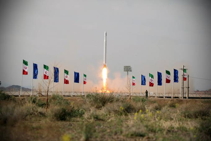 A first military satellite named Noor is launched into orbit by Iran's Revolutionary Guards Corps, in Semnan