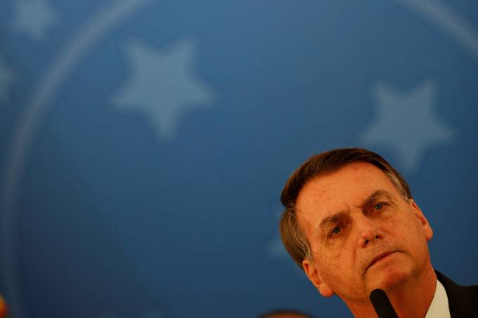 Brazil's President Jair Bolsonaro addresses the media during a news conference at the Planalto Palace