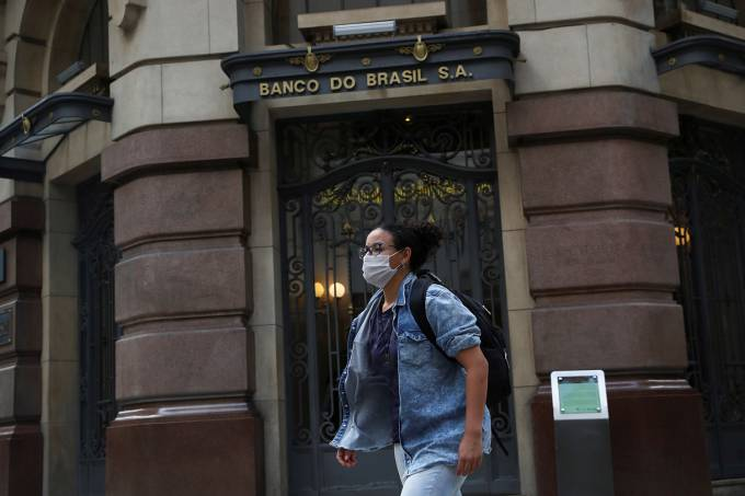 A woman wearing a protective face mask walks in front of Banco do Brasil (Bank of Brazil) cultural building during the coronavirus disease (COVID-19) outbreak in Sao Paulo