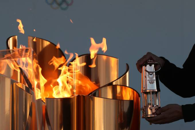 Olympic Flame Displayed A Day After Tokyo Games Postponement Announced