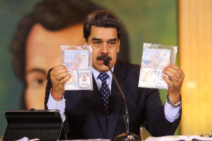 Personal documents are shown by Venezuela's President Nicolas Maduro during a virtual news conference in Caracas