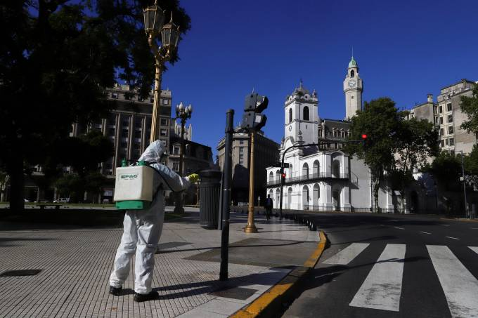 FILE PHOTO: A worker disinfects Plaza de Mayo after Argentina's President Alberto Fernandez announced a mandatory quarantine as a measure to curb the spread of coronavirus disease (COVID-19), in Buenos Aires