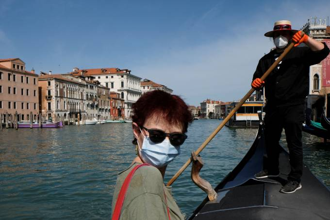 Gondoliers resume their service on the Grand Canal as Italy eases some more of the lockdown measures put in place during the coronavirus disease (COVID-19) outbreak, in Venice