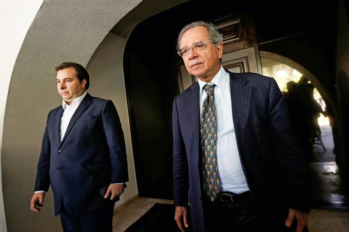 Brazil's Lower House President Rodrigo Maia and Brazil's Economy Minister Paulo Guedes are seen after a meeting in Brasilia