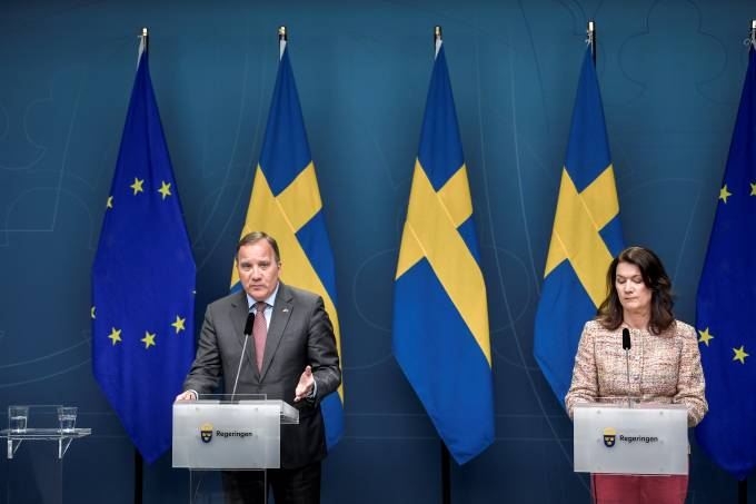Sweden's Prime Minister Stefan Lofven speaks next to Sweden's Foreign Minister Ann Linde during a news conference on the coronavirus disease (COVID-19) situation, in Stockholm