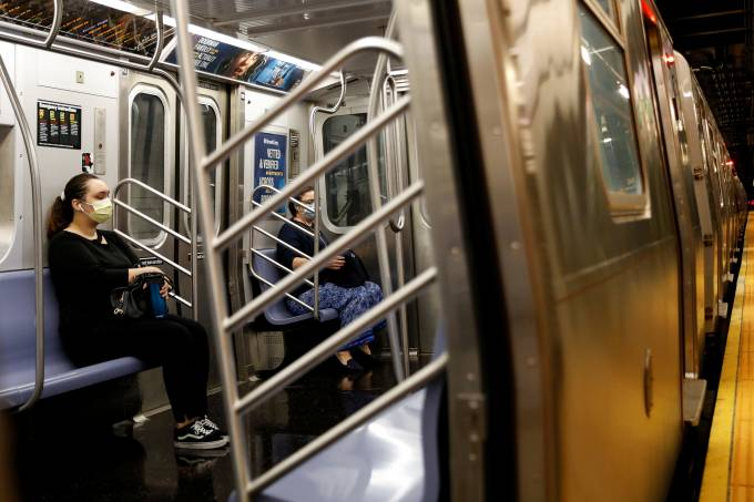 Morning commuters ride an MTA subway, as phase one of reopening after lockdown begins, during the outbreak of the coronavirus disease (COVID-19) in New York