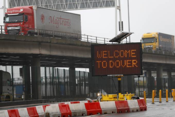 FILE PHOTO: A general view shows vehicles arriving at port on Brexit day, in Dover