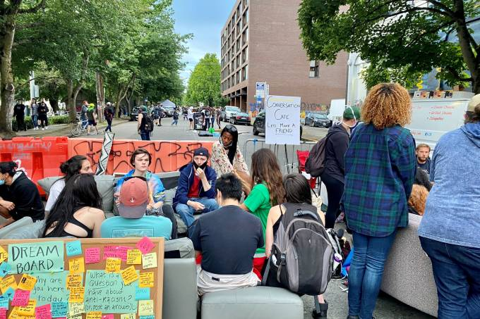 People sit inside the Capitol Hill Autonomous Zone (CHAZ) in Seattle