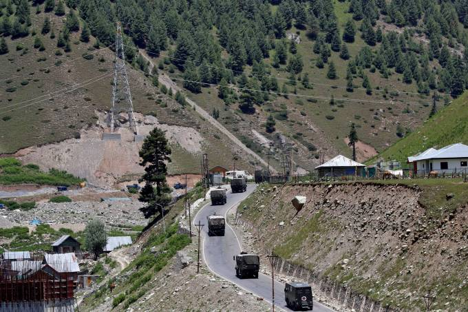 Indian army convoy moves along Srinagar-Leh national highway, at Gagangeer, in east Kashmir's Ganderbal district