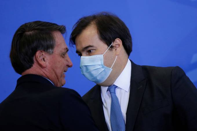 Brazils President Jair Bolsonaro greets President of Brazil's Lower House Rodrigo Maia during an inauguration ceremony of the new Communications Minister Fabio Faria (not pictured) at the Planalto Palace, in Brasilia