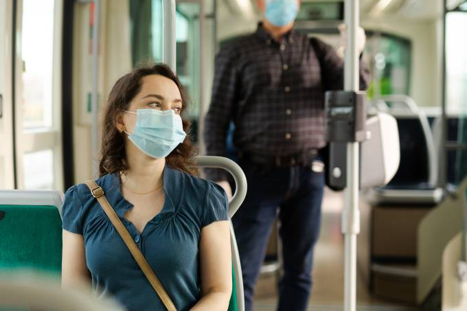 Woman in medical mask sitting in streetcar